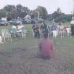 The prayer group grew larger in the field.